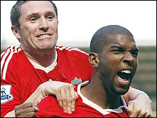 Ryan Babel (right) celebrates with Robbie Keane after his winner against Manchester United