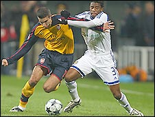 Arsenal striker Robin van Persie (left) struggles to get away from Ayila Yussuf in his side's game against Dynamo Kiev