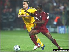 Yssouf Kone of CFR Cluj-Napoca takes on John Terry of Chelsea