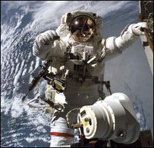 a 70 kg astronaut in space walking outside - photo #12