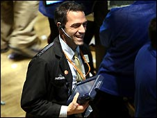 A trader on the New York Stock Exchange reacts to the high close (28 Oct)
