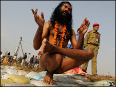 A Hindu holy man performs yoga postures during the Ardh Kumbh Mela festival in Allahabad, India (file photo)