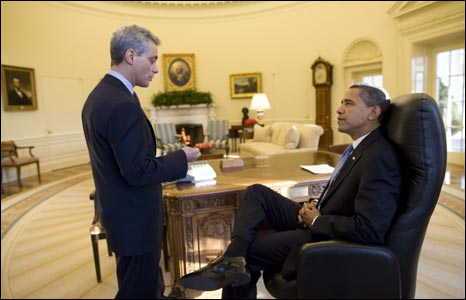 President Obama talks to his White House Chief of Staff Rahm Emanuel in the Oval Office at the White House, 21 January 2009