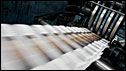 Copies of the San Francisco Chronicle roll off the production line (File picture)