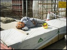 A worker asleep on contruction site