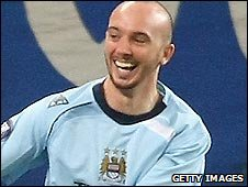 Man City's Stephen Ireland shows his delight at his opener against Hamburg
