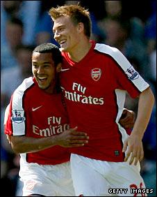 Theo Walcott congratulates Nicklas Bendtner