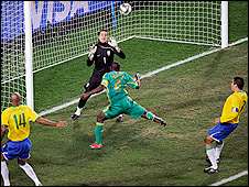 South Africa captain Aaron Mokoena heads high at the far post against Brazil