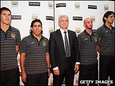 Manchester City players with boss Mark Hughes