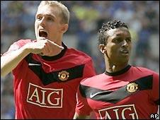 Nani (right) celebrates scoring with Darren Fletcher