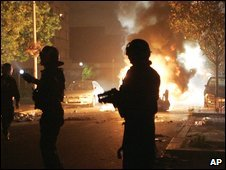 French riot police near a burning car in Bagnolet, Paris, 11 August 2009
