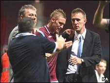 West Ham midfielder Jack Collison, whose father died on Sunday, is helped off the pitch