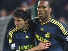 Didier Drogba (Right) celebrates scoring with Yuri Zhirkov