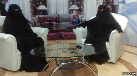 Two women TV presenters in Saudi Arabia dressed in the Niqab