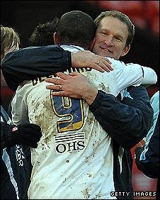 Simon Grayson congratulates goal scorer Jermaine Beckford