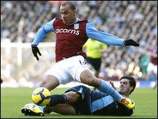 Gabriel Agbonlahor tackled by James Tomkins
