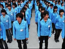 Chinese workers in Shenzhen queue up to enter factory