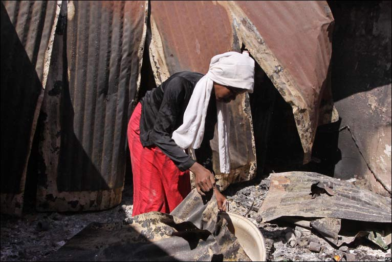 Aisha Baba salvages goods from her burnt out house in Jos