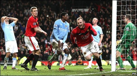 Wayne Rooney celebrates scoring the winner
