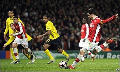 Cesc Fabregas scores a late penalty
