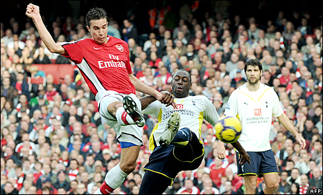 Robin van Persie gets ahead of Ledley King to score Arsenal first  goal in their 3-0 victory over Totenham in October