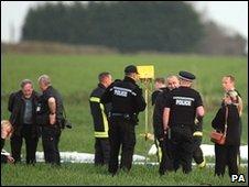 Investigators at the scene of the crash in Monxton