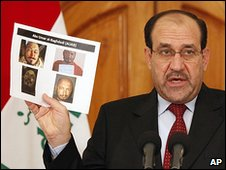 Nouri Maliki with picture of Abu Omar al-Baghdadi
