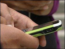 Teenager texting (file image)