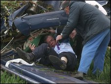 Nigel Farage being rescued from the plane wreckage