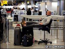 Travellers wait inside Terminal 3 of Heathrow Airport